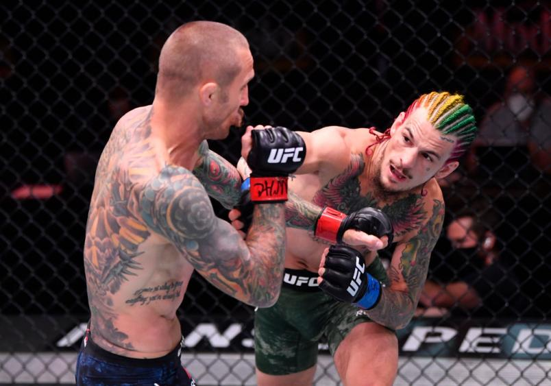 JUNE 06: (R-L) Sean O'Malley punches Eddie Wineland in their bantamweight bout during the UFC 250 event at UFC APEX on June 06, 2020 in Las Vegas, Nevada. (Photo by Jeff Bottari/Zuffa LLC)