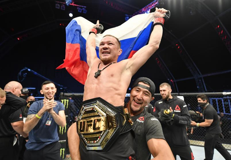 Petr Yan of Russia celebrates after his TKO victory over Jose Aldo in their UFC bantamweight championship fight during the UFC 251 event at Flash Forum on UFC Fight Island on July 12, 2020 on Yas Island, Abu Dhabi, United Arab Emirates. (Photo by Jeff Bottari/Zuffa LLC)