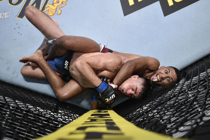 Youssef Zalal of Morocco attempts to secure a rear choke submission against Peter Barrett in their featherweight fight during the UFC Fight Night event at UFC APEX on August 08, 2020 in Las Vegas, Nevada. (Photo by Chris Unger/Zuffa LLC)