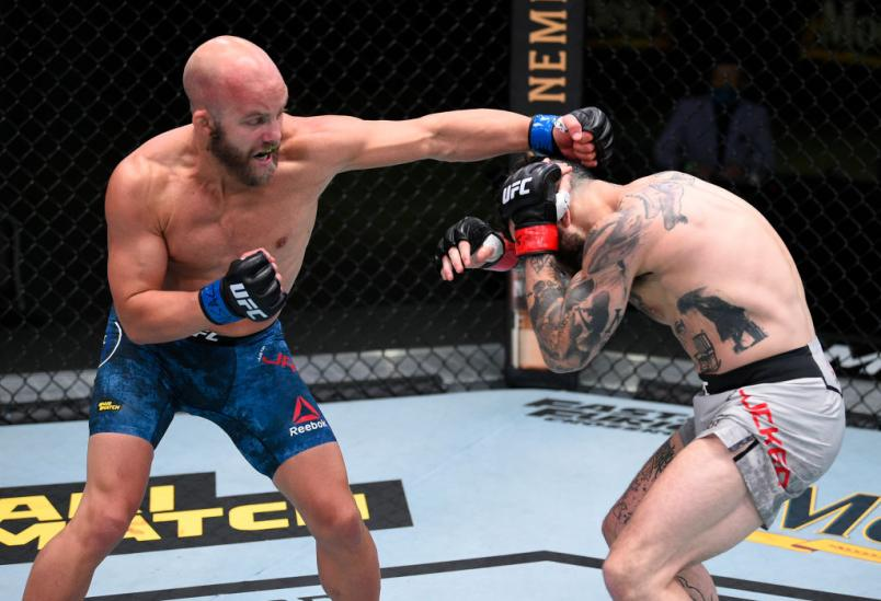 LAS VEGAS, NEVADA - AUGUST 08: (L-R) Justin Jaynes punches Gavin Tucker of Canada in their featherweight fight during the UFC Fight Night event at UFC APEX on August 08, 2020 in Las Vegas, Nevada. (Photo by Chris Unger/Zuffa LLC)