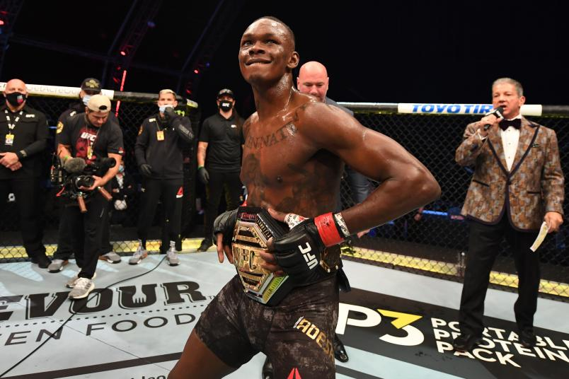 Israel Adesanya of Nigeria celebrates after defeating Paulo Costa of Brazil in their middleweight championship bout during UFC 253 inside Flash Forum on UFC Fight Island on September 27, 2020 in Abu Dhabi, United Arab Emirates. (Photo by Josh Hedges/Zuffa LLC)