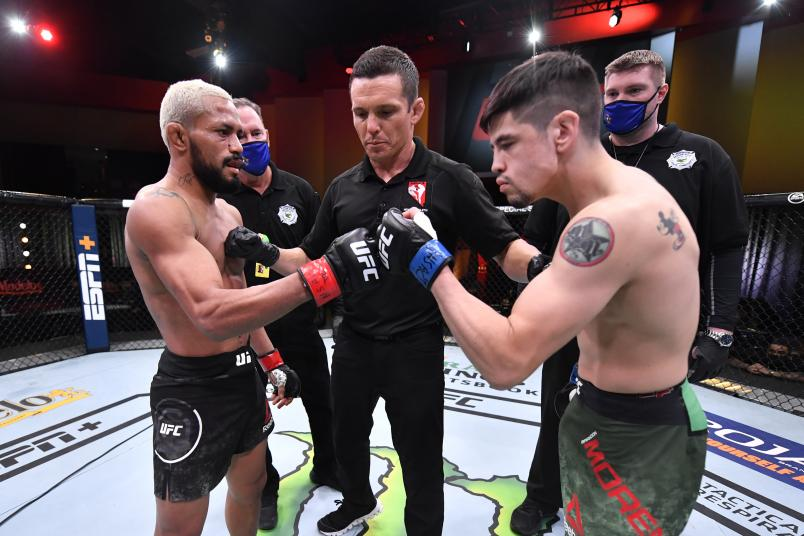 Deiveson Figueiredo of Brazil and Brandon Moreno of Mexico touch gloves prior to their flyweight championship bout during the UFC 256 event at UFC APEX on December 12, 2020 in Las Vegas, Nevada. (Photo by Jeff Bottari/Zuffa LLC)