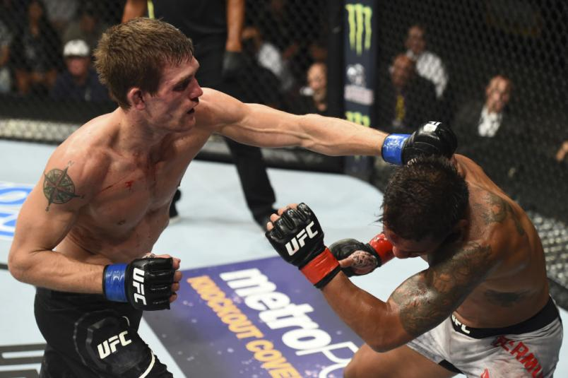 JULY 14: (L-R) Rick Glenn punches Dennis Bermudez in their featherweight fight during the UFC Fight Night event inside CenturyLink Arena on July 14, 2018 in Boise, Idaho. (Photo by Josh Hedges/Zuffa LLC)