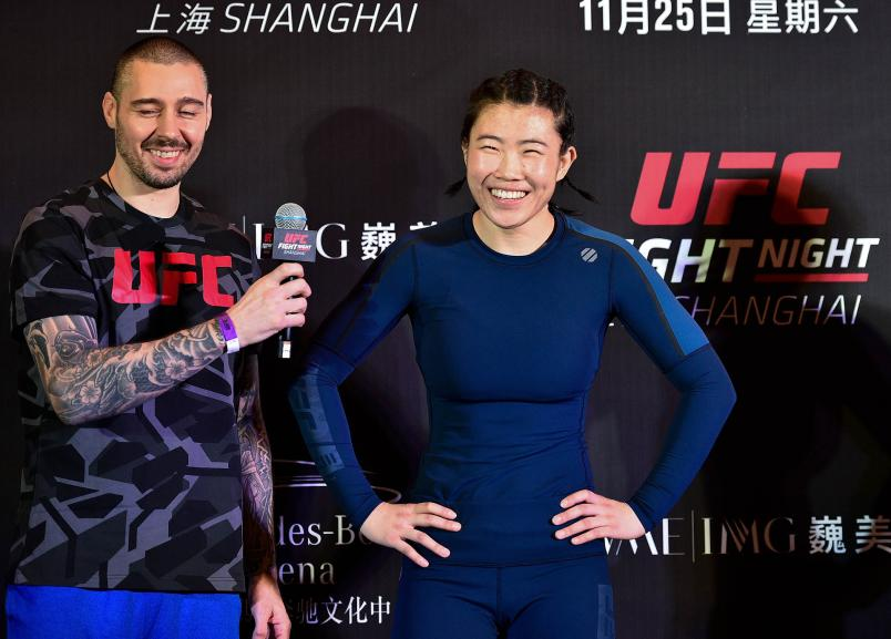 Dan Hardy speaks with Wu Yanan after her open workout session on November 23, 2017 in Shanghai, China. (Photo by Brandon Magnus/Zuffa LLC)