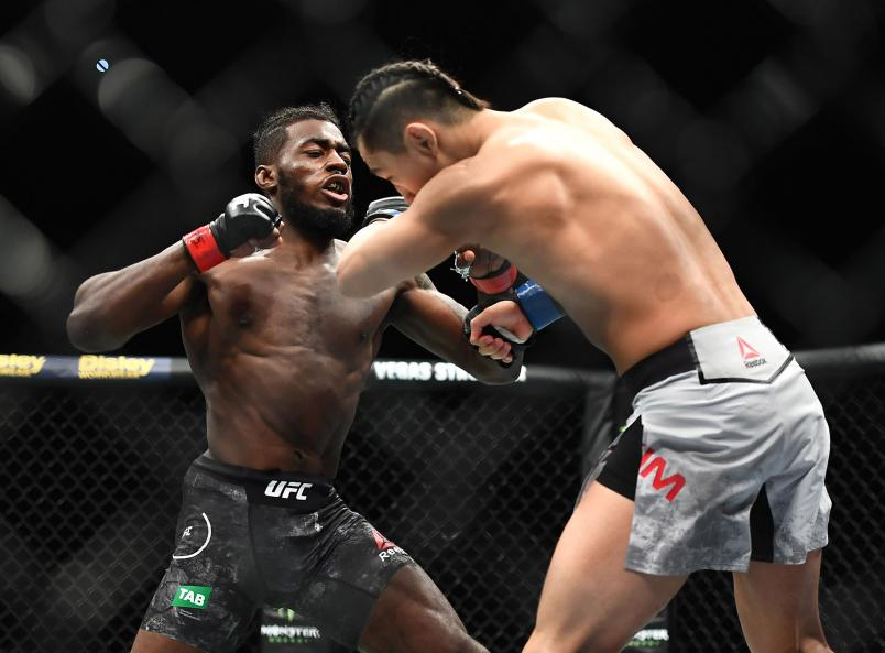 Devonte Smith lands a punch in his fight against Dong Hyun Ma in their Lightweight fight during UFC234 at Rod Laver Arena on February 10, 2019 in Melbourne, Australia. (Photo by Quinn Rooney/Getty Images)