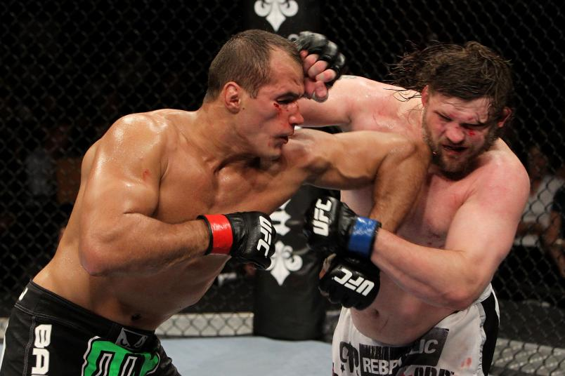 Junior dos Santos elbows Roy Nelson during their UFC Heavyweight bout at Oracle Arena on August 7, 2010 in Oakland, California. (Photo by Josh Hedges/Zuffa LLC)