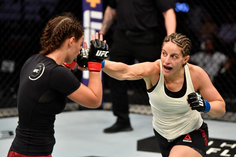 Sarah Moras of Canada punches Liana Jojua of Georgia in their women's bantamweight bout during UFC 242 at The Arena on September 7, 2019 in Yas Island, Abu Dhabi, United Arab Emirates. (Photo by Jeff Bottari/Zuffa LLC)