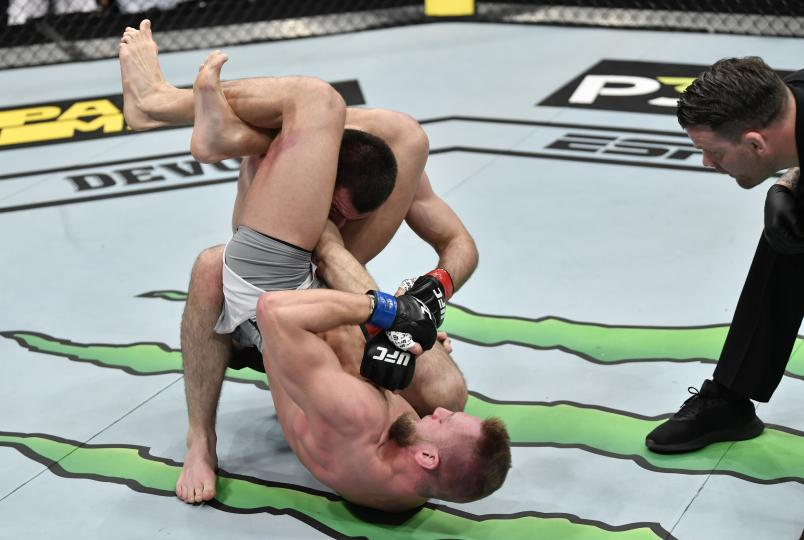 David Zawada of Germany secures a triangle arm bar submission against Abubakar Nurmagomedov of Russia in their welterweight bout during the UFC Fight Night event at CSKA Arena on November 09, 2019 in Moscow, Russia. (Photo by Jeff Bottari/Zuffa)