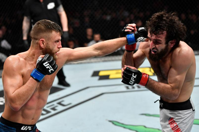 Calvin Kattar punches Zabit Magomedsharipov of Russia in their featherweight fight during the UFC Fight Night event at CSKA Arena on November 09, 2019 in Moscow, Russia. (Photo by Jeff Bottari/Zuffa LLC)