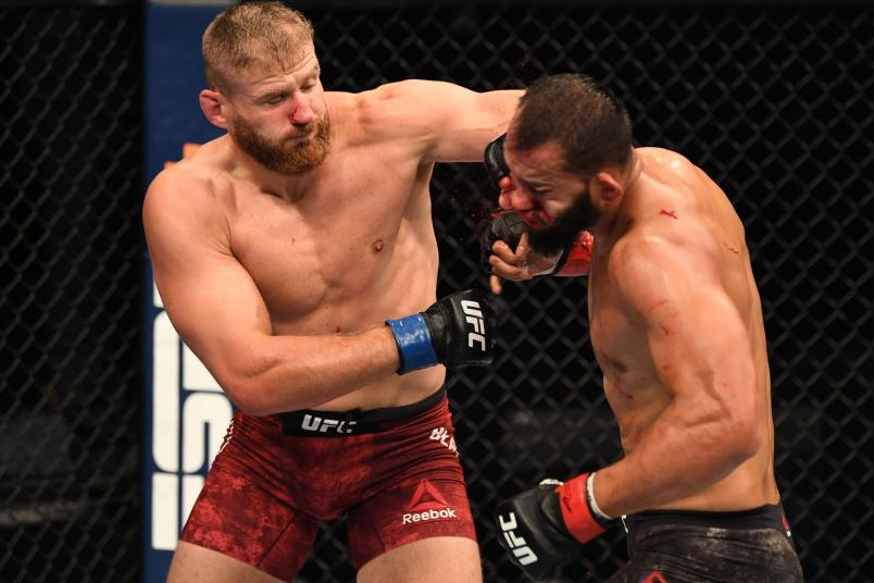 Jan Blachowicz punches Dominick Reyes in their light heavyweight championship bout during UFC 253 inside Flash Forum on UFC Fight Island on September 27, 2020 in Abu Dhabi, United Arab Emirates. (Photo by Josh Hedges/Zuffa LLC)