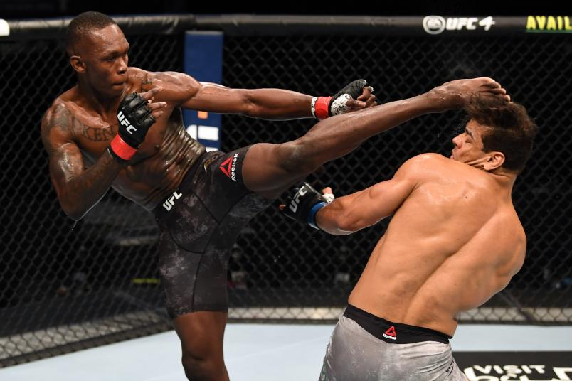 Israel Adesanya of Nigeria kicks the head of Paulo Costa of Brazil in their middleweight championship bout during UFC 253 inside Flash Forum on UFC Fight Island on September 27, 2020 in Abu Dhabi, United Arab Emirates. (Photo by Josh Hedges/Zuffa LLC)