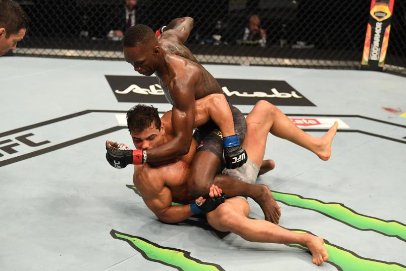 Israel Adesanya punches Paulo Costa in their middleweight championship bout during UFC 253 inside Flash Forum on UFC Fight Island on September 27, 2020 in Abu Dhabi, United Arab Emirates. (Photo by Josh Hedges/Zuffa LLC)