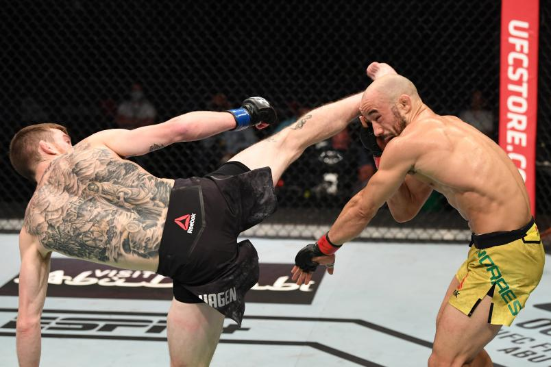 Cory Sandhagen kicks Marlon Moraes of Brazil in their bantamweight bout during the UFC Fight Night event inside Flash Forum on UFC Fight Island on October 11, 2020 in Abu Dhabi, United Arab Emirates. (Photo by Josh Hedges/Zuffa LLC)