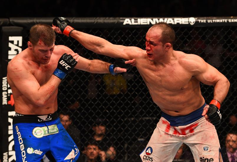 Junior Dos Santos of Brazil punches Stipe Miocic in their heavyweight fight during the UFC Fight Night event at the U.S. Airways Center on December 13, 2014 in Phoenix, Arizona. (Photo by Josh Hedges/Zuffa LLC)