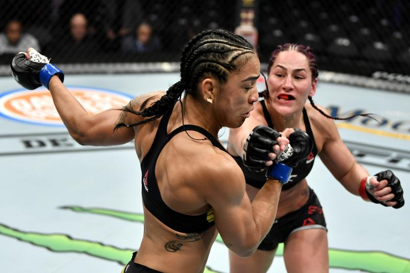 Jessica Eye punches Viviane Araujo of Brazil in their women's flyweight bout during the UFC 245 event at T-Mobile Arena on December 14, 2019 in Las Vegas, Nevada. (Photo by Jeff Bottari/Zuffa LLC)
