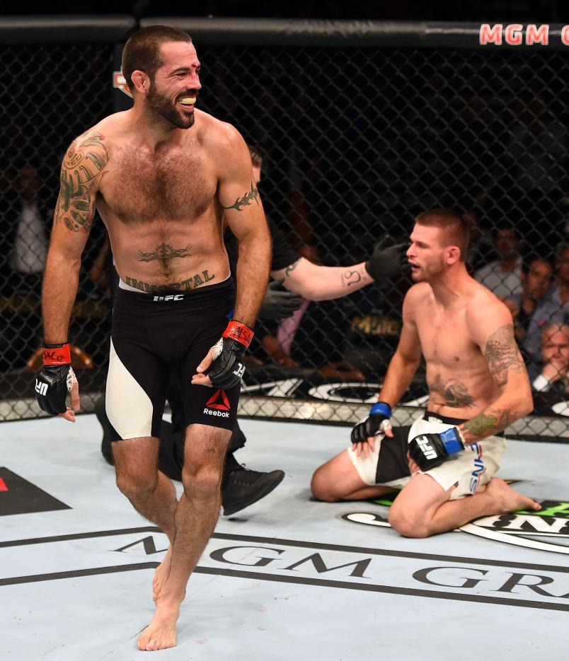 Matt Brown (left) reacts to his victory over Tim Means in their welterweight fight during the UFC 189 event inside MGM Grand Garden Arena on July 11, 2015 in Las Vegas, Nevada. (Photo by Josh Hedges/Zuffa LLC)