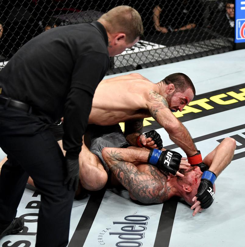 Matt Brown finishes Ben Saunders in their welterweight bout during the UFC 245 event at T-Mobile Arena on December 14, 2019 in Las Vegas, Nevada. (Photo by Jeff Bottari/Zuffa LLC)