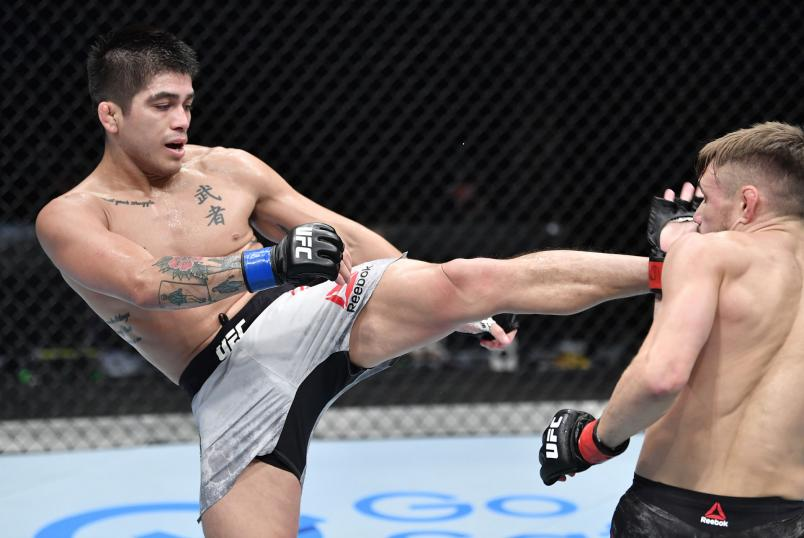 John Castaneda kicks Nathaniel Wood of England in their bantamweight fight during the UFC Fight Night event inside Flash Forum on UFC Fight Island on July 26, 2020 in Yas Island, Abu Dhabi, United Arab Emirates. (Photo by Jeff Bottari/Zuffa LLC via Getty Images)