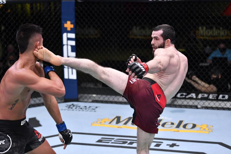 Timur Valiev of Russia kicks Martin Day in their featherweight fight during the UFC Fight Night event at UFC APEX on February 06, 2021 in Las Vegas, Nevada. (Photo by Chris Unger/Zuffa LLC)