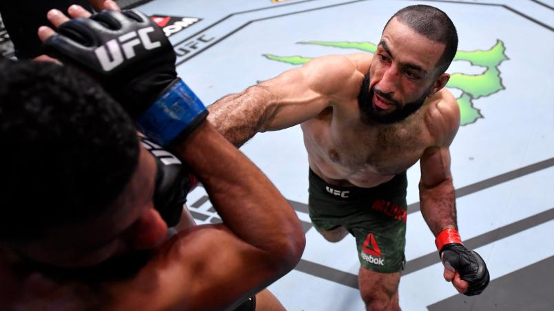 Belal Muhammad punches Dhiego Lima of Brazil in their welterweight fight during the UFC 258 event at UFC APEX on February 13, 2021 in Las Vegas, Nevada. (Photo by Jeff Bottari/Zuffa LLC)