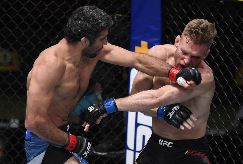 Beneil Dariush of Iran punches Scott Holtzman in their lightweight fight during the UFC Fight Night event at UFC APEX on August 08, 2020 in Las Vegas, Nevada. (Photo by Chris Unger/Zuffa LLC)