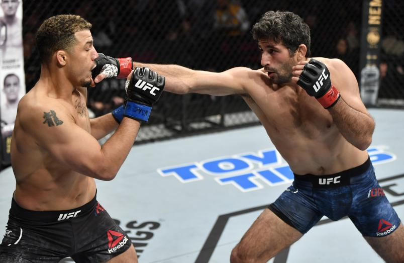 Beneil Dariush punches Drakkar Klose in their lightweight fight during the UFC 248 event at T-Mobile Arena on March 07, 2020 in Las Vegas, Nevada. (Photo by Jeff Bottari/Zuffa LLC)