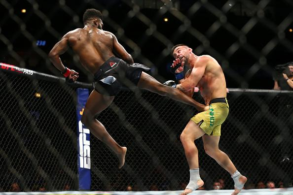 Aljamain Sterling (L) kicks Pedro Munhoz at United Center on June 8, 2019 in Chicago, Illinois. (Photo by Rey Del Rio/Getty Images)