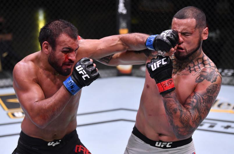 Gabe Green punches Daniel Rodriguez in their welterweight fight during the UFC Fight Night event at UFC APEX on May 30, 2020 in Las Vegas, Nevada. (Photo by Jeff Bottari/Zuffa LLC)