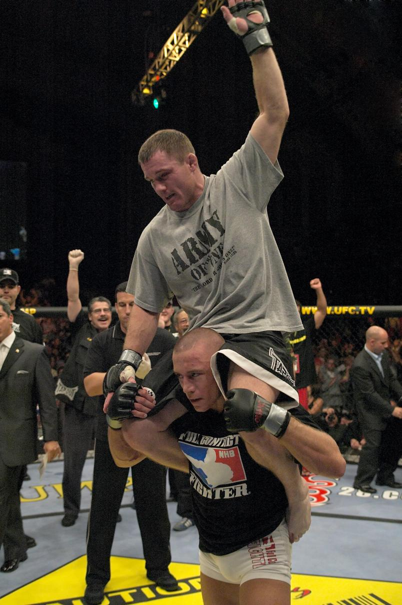 Matt Hughes is hoisted up on Georges St-Pierre's shoulders after Hughes defeated St-Pierre in their welterweight championship bout at UFC 50 at the Boardwalk Hall on October 22, 2004 in Atlantic City, New Jersey. (Photo by Josh Hedges/Zuffa LLC)