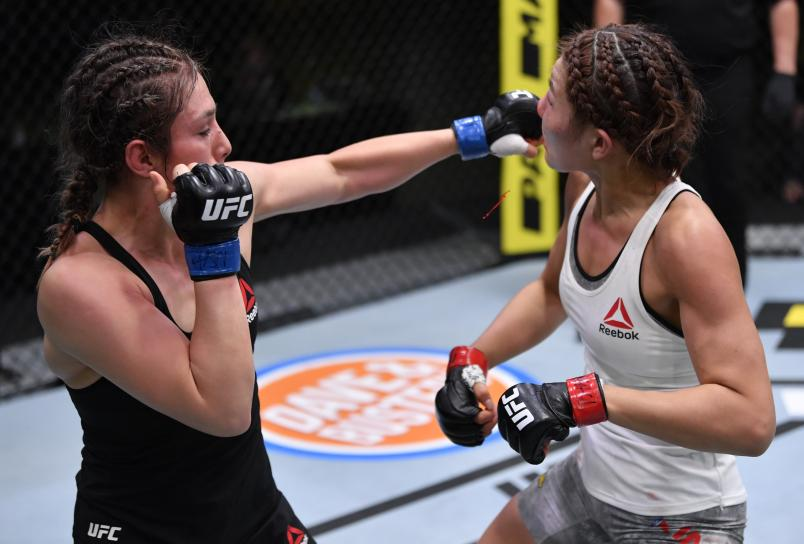 Alexa Grasso of Mexico punches Ji Yeon Kim of South Korea in their flyweight fight during the UFC Fight Night event at UFC APEX on August 29, 2020 in Las Vegas, Nevada. (Photo by Jeff Bottari/Zuffa LLC)