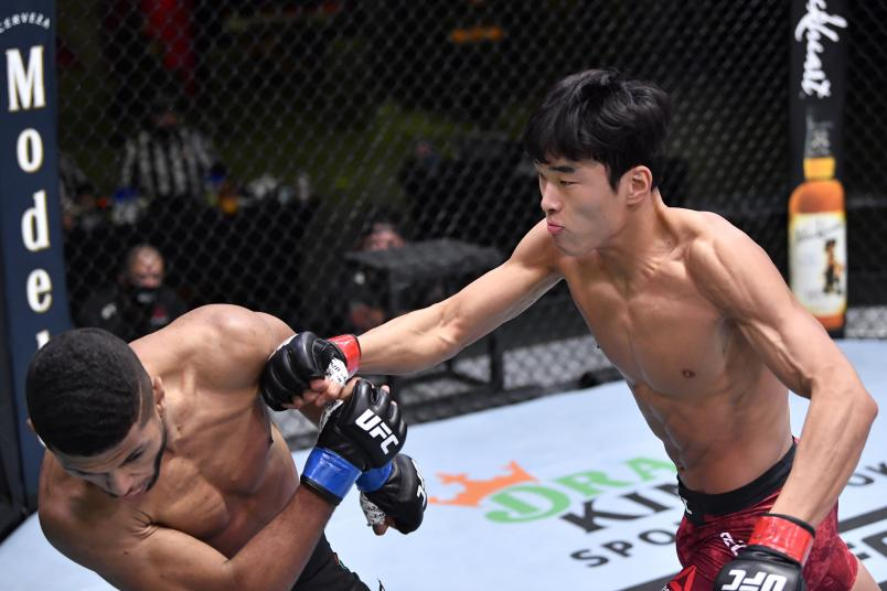 Seungwoo Choi of South Korea punches Youssef Zalal of Morocco in their featherweight fight during the UFC Fight Night event at UFC APEX on February 06, 2021 in Las Vegas, Nevada. (Photo by Chris Unger/Zuffa LLC)