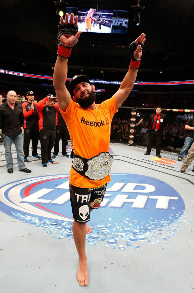Johny Hendricks reacts after defeating Robbie Lawler in their UFC welterweight championship bout at UFC 171 inside American Airlines Center on March 15, 2014 in Dallas, Texas. (Photo by Josh Hedges/Zuffa LLC)