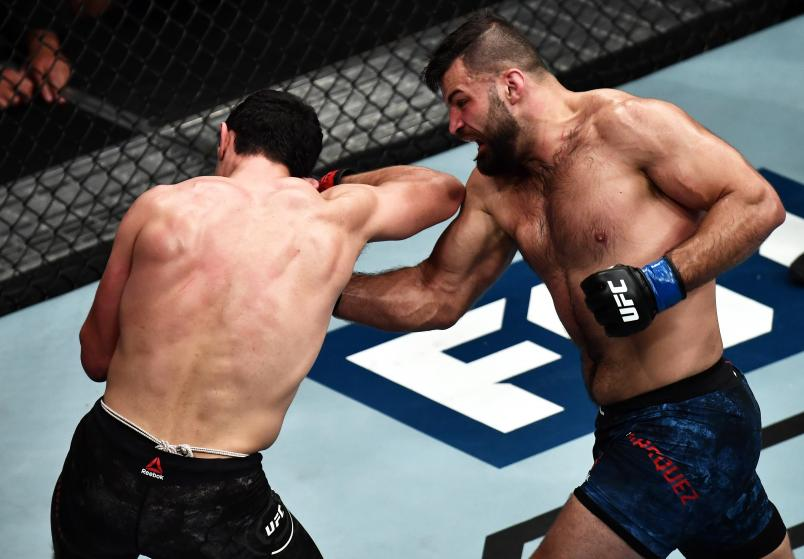 Julian Marquez punches Alessio Di Chirico of Itlay during The Ultimate Fighter Finale event inside The Pearl concert theater at Palms Casino Resort on July 6, 2018 in Las Vegas, Nevada. (Photo by Brandon Magnus/Zuffa LLC)