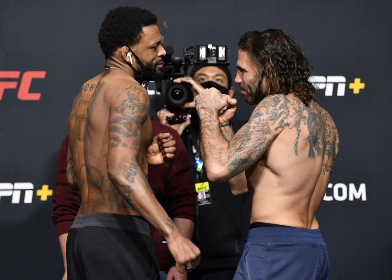 Opponents Michael Johnson and Clay Guida face off during the UFC weigh-in at UFC APEX on February 05, 2021 in Las Vegas, Nevada. (Photo by Chris Unger/Zuffa LLC)