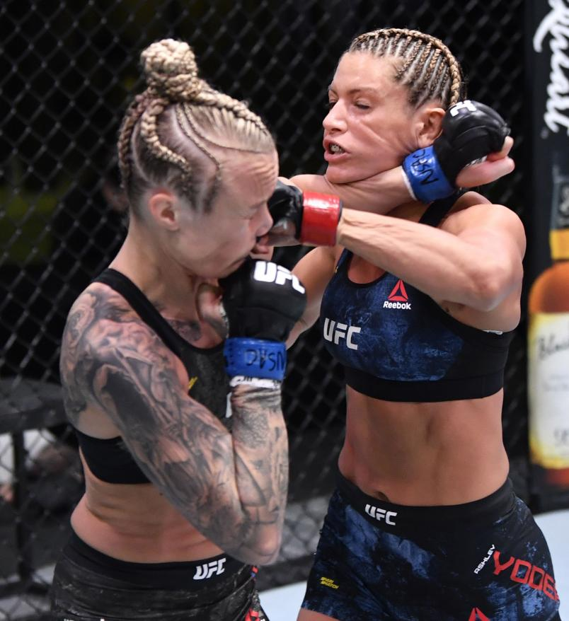 LAS VEGAS, NEVADA - NOVEMBER 14: (R-L) Ashley Yoder and Miranda Granger trade punches in a strawweight fight during the UFC Fight Night event at UFC APEX on November 14, 2020 in Las Vegas, Nevada. (Photo by Jeff Bottari/Zuffa LLC)