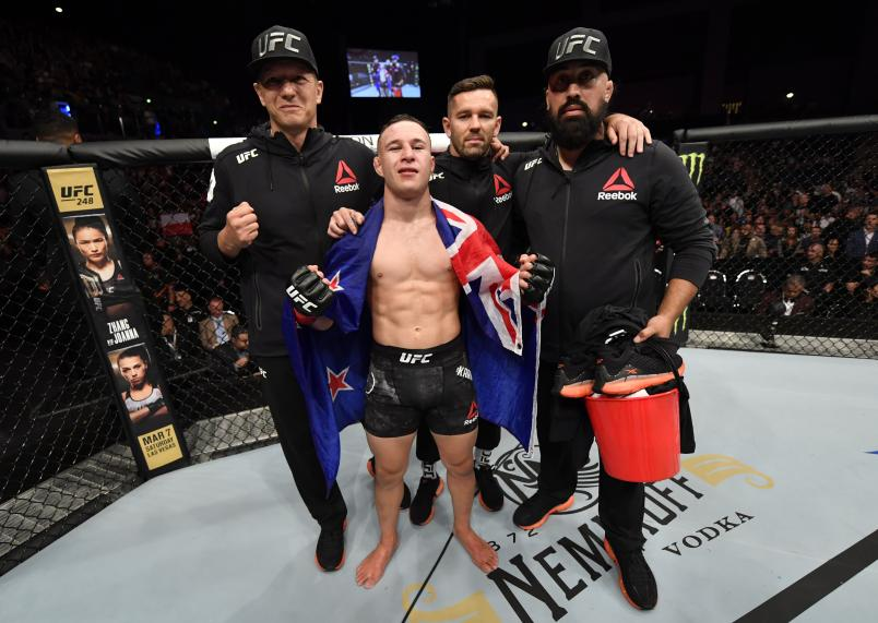 Kai Kara-France of New Zealand poses with his team after defeating Tyson Nam in their flyweight bout during the UFC Fight Night event at Spark Arena on February 23, 2020 in Auckland, New Zealand. (Photo by Jeff Bottari/Zuffa LLC)