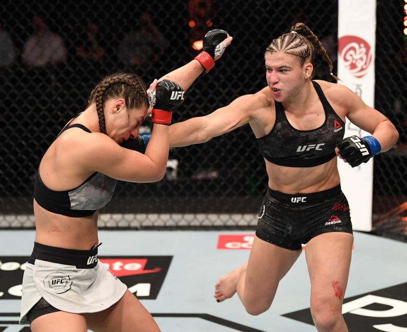 Miranda Maverick punches Liana Jojua of Georgia in their women's flyweight bout during the UFC 254 event on October 24, 2020 on UFC Fight Island, Abu Dhabi, United Arab Emirates. (Photo by Josh Hedges/Zuffa LLC via Getty Images)