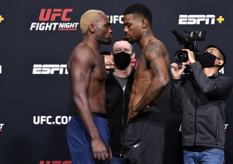 Derek Brunson and Kevin Holland face off during the UFC weigh-in at UFC APEX on March 19, 2021 in Las Vegas, Nevada. (Photo by Chris Unger/Zuffa LLC)