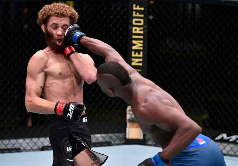 Khama Worthy punches Luis Pena in their lightweight fight during the UFC Fight Night event at UFC APEX on June 27, 2020 in Las Vegas, Nevada. (Photo by Chris Unger/Zuffa LLC)