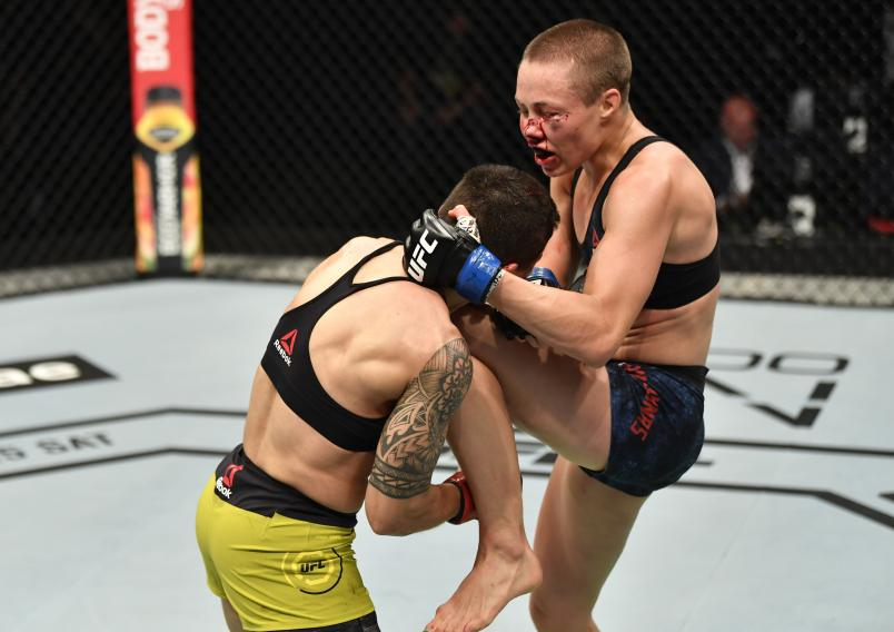 Rose Namajunas knees Jessica Andrade of Brazil in their strawweight fight during the UFC 251 event at Flash Forum on UFC Fight Island on July 12, 2020 on Yas Island, Abu Dhabi, United Arab Emirates. (Photo by Jeff Bottari/Zuffa LLC)