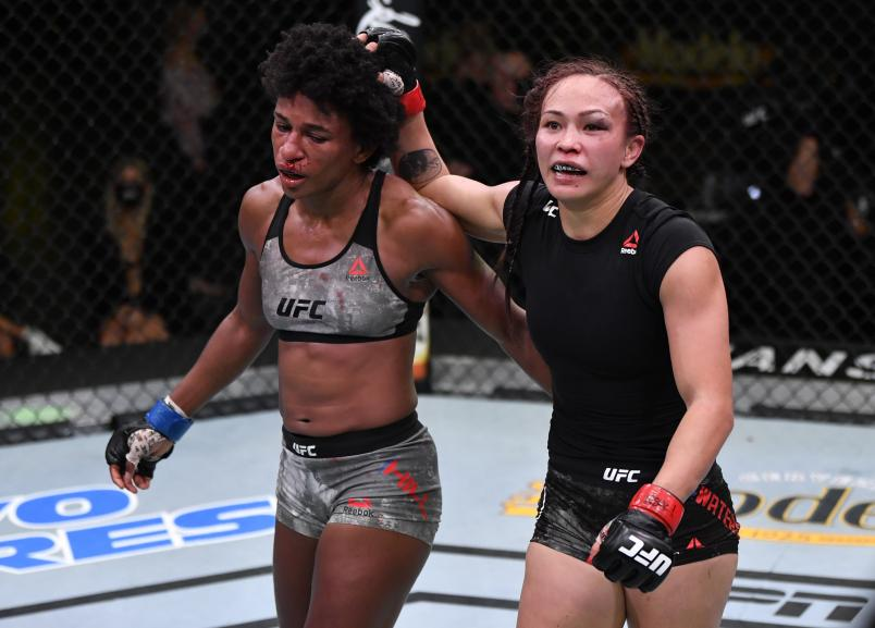 Michelle Waterson and Angela Hill react after the conclusion of their five-round strawweight battle during the UFC Fight Night event at UFC APEX on September 12, 2020 in Las Vegas, Nevada. (Photo by Jeff Bottari/Zuffa LLC)
