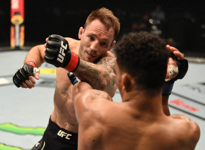Brad Riddell of New Zealand punches Alex da Silva of Brazil in their lightweight bout during UFC 253 inside Flash Forum on UFC Fight Island on September 27, 2020 in Abu Dhabi, United Arab Emirates. (Photo by Josh Hedges/Zuffa LLC)