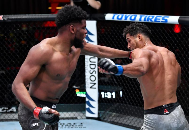 Kennedy Nzechukwu of Nigeria punches Carlos Ulberg of New Zealand in their light heavyweight fight during the UFC 259 event at UFC APEX on March 06, 2021 in Las Vegas, Nevada. (Photo by Jeff Bottari/Zuffa LLC)