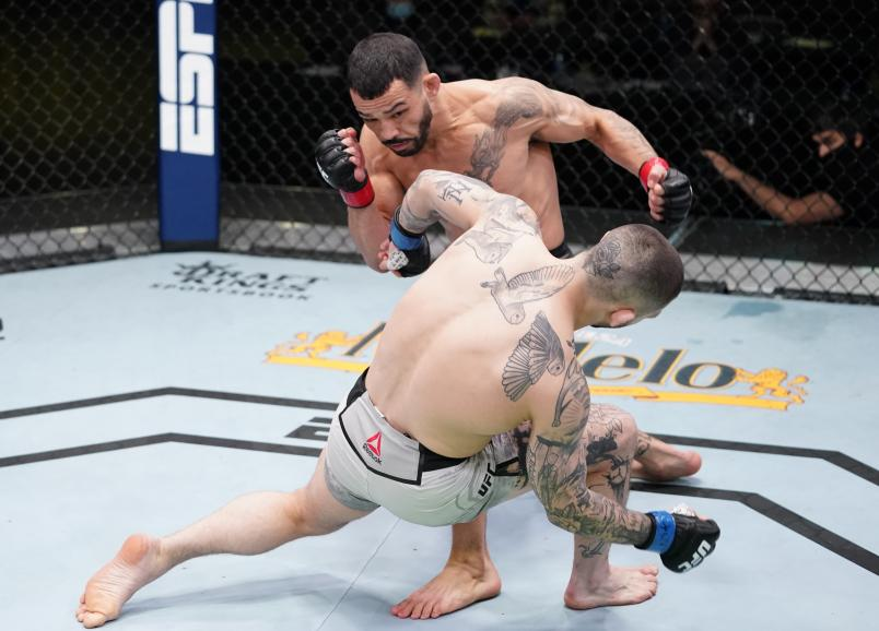 Dan Ige knocks out Gavin Tucker of Canada in a featherweight fight during the UFC Fight Night event at UFC APEX on March 13, 2021 in Las Vegas, Nevada. (Photo by Jeff Bottari/Zuffa LLC)