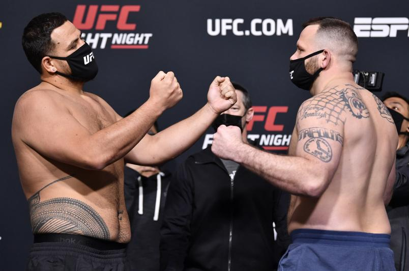 Tai Tuivasa of Australia and Harry Hunsucker face off during the UFC weigh-in at UFC APEX on March 19, 2021 in Las Vegas, Nevada. (Photo by Chris Unger/Zuffa LLC)