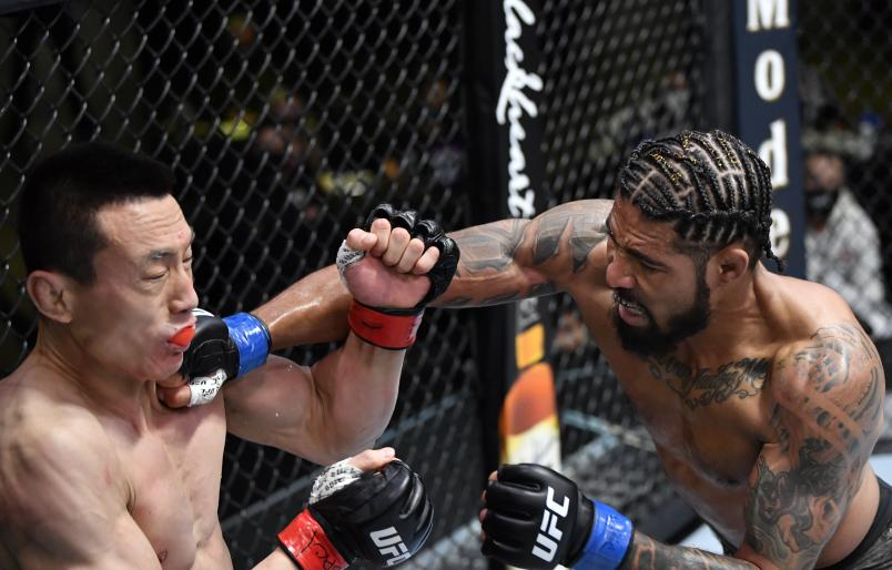 Max Griffin punches Song Kenan of China in their welterweight fight during the UFC Fight Night event at UFC APEX on March 20, 2021 in Las Vegas, Nevada. (Photo by Chris Unger/Zuffa LLC )