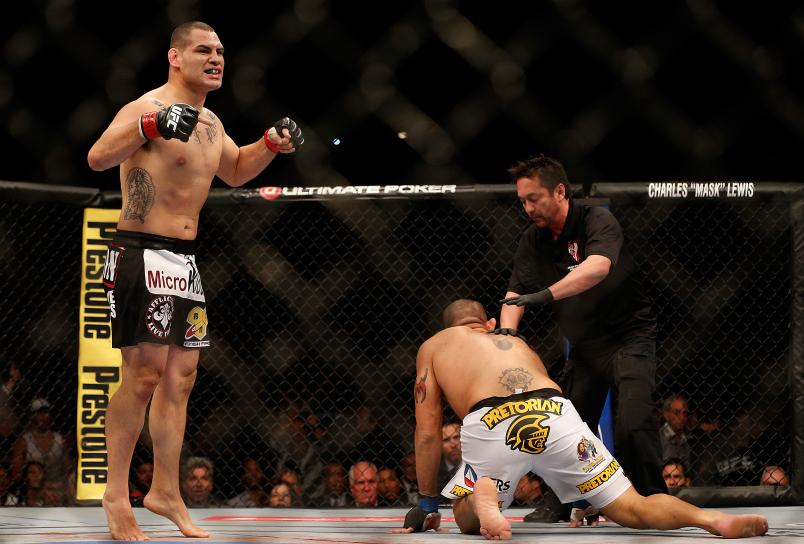 """Cain Velasquez reacts after knocking out Antonio """"Bigfoot"""" Silva in their heavyweight championship bout during UFC 160 at the MGM Grand Garden Arena on May 25, 2013 in Las Vegas, Nevada. (Photo by Josh Hedges/Zuffa LLC)"""