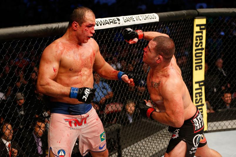 Cain Velasquez punches Junior Dos Santos in their UFC heavyweight championship bout at the Toyota Center on October 19, 2013 in Houston, Texas. Cain Velasquez defeated Junior Dos Santos by TKO. (Photo by Josh Hedges/Zuffa LLC)