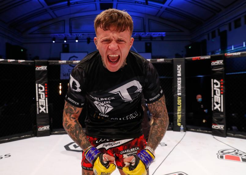 Jordan Lucenic Postes For A Photo After A Cage Warriors Bout