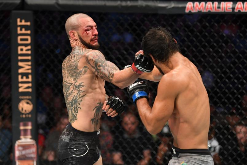 Cub Swanson punches Kron Gracie of Brazil in their featherweight bout during the UFC Fight Night event at Amalie Arena on October 12, 2019 in Tampa, Florida. (Photo by Josh Hedges/Zuffa LLC)